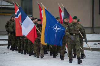 NATO troops on parade during a ceremony in Lithuania to mark the first anniversary of enhanced Forward Presence