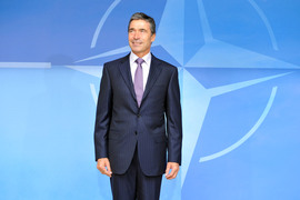 New NATO Secretary General, Anders Fogh Rasmussen poses in front of the NATO logo at the Main Entrance to the Headquarters