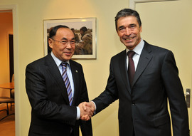 Left to right:  Kanat Saudabayev (Minister of Foreign Affairs of Kazakhstan) shaking hands with NATO Secretary General, Anders Fogh Rasmussen.