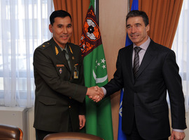 Left to right: The Minister of Defence of Turkmenistan, Major General Yaylym Berdiyev, shaking hands with NATO Secretary General, Anders Fogh Rasmussen.