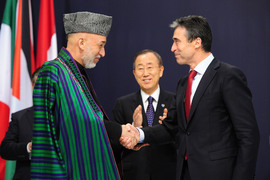 The President of Afghanistan, Hamid Karzai and NATO Secretary General Anders Fogh Rasmussen shake hands after signing a declaration on Enduring Partnership.