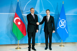 Arrival Left to right:  President Ilham Heydar oglu Aliyev of Azerbaijan shaking hands with NATO Secretary General Anders Fogh Rasmussen