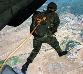 "A Spanish parachutist jumps out of the plane over the military camp at Bize near the Albanian capital Tirana Sunday, August 18, 1998. The parachutist takes  part in the N.A.T.O. Cooperative Assembly «98  Partnership for Peace"" in Albania. Pictures made available at August 20, 1998.  (AP PHOTO/Andreas Noll)"