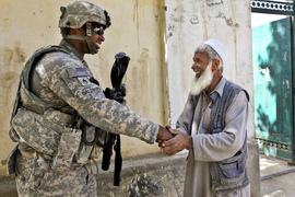 U.S. Army Staff Sgt. Michael Baldwin from Virginia Beach, Va., shakes the hand of an elder in the village of Shesh Khala, June 1, Logar province, Afghanistan. Baldwin is assigned to the 401st Military Police Company, 720th MP Battalion, 89th MP Brigade.