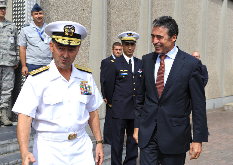 NATO Secretary General Anders Fogh Rasmussen is welcomed by the Supreme Allied Commander Europe, Admiral James Stavridis
