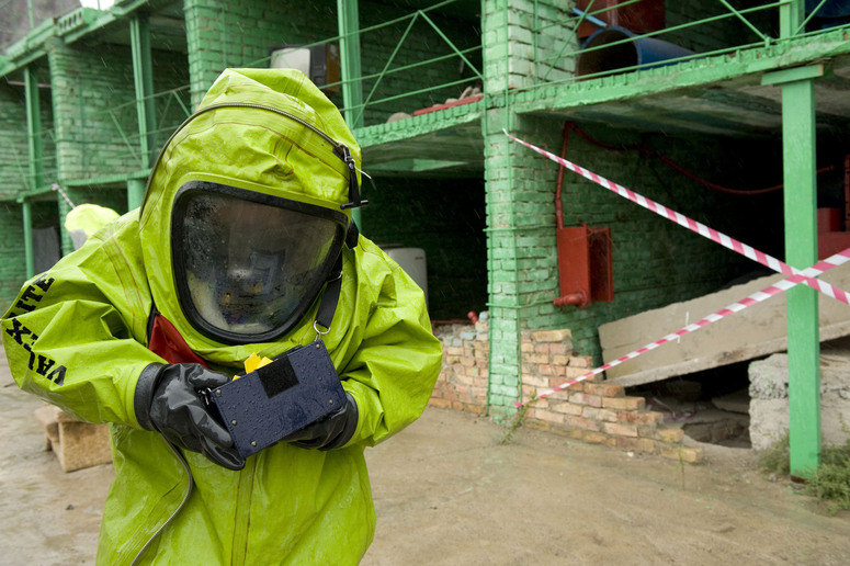 Chemical sampling in protective suit.