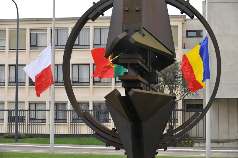 Flags flying half-mast at NATO headquarters.
