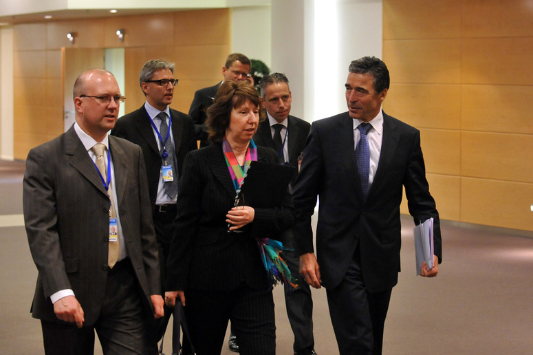 Centre to right: Baroness Catherine Ashton (EU High Representative for Foreign Affairs and Security Policy) walking towards the meeting room with NATO Secretary General, Anders Fogh Rasmussen