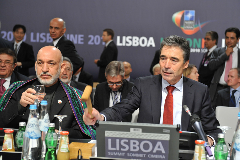 NATO Secretary General Anders Fogh Rasmussen opens the meeting. Afghan President Hamid Karzai (left).