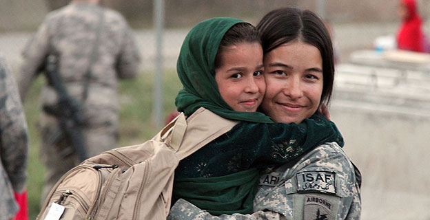 U.S. Army Spc. Jessica Walker from Killingworth, Conn., shares a hug with an Afghan child at a Girl Scout meeting on Forward Operating Base Finley Shields, Nangarhar province, Afghanistan, Oct 9. (U.S Army photo by Pfc. Cameron Boyd) 101009-A-1728B-202 https://www.flickr.com/photos/isafmedia/5080386066/