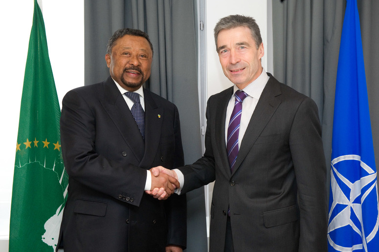 Left to right: Jean Ping, Chairman of the African Union shaking hands with NATO Secretary General, Anders Fogh Rasmussen