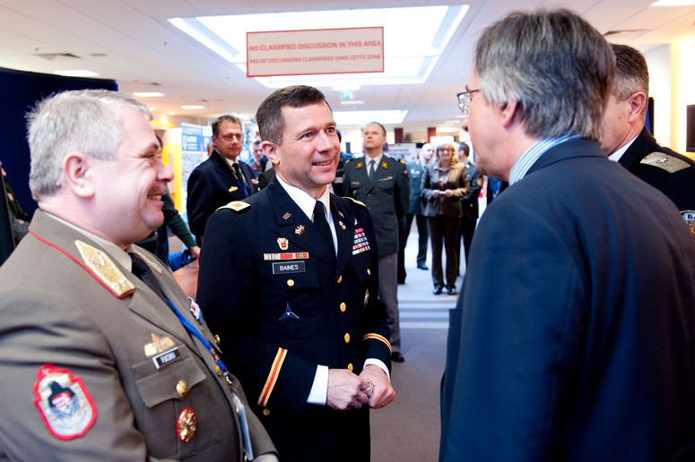 Major General Sándor Fucsku, Deputy Chief of Staff for the Military Cooperation Division (left), NATO School Commandant Colonel Mark Baines (center) and NATO's Assistant Secretary General for Political Affairs and Security Policy, Ambassador Dirk Brengelmann (right)