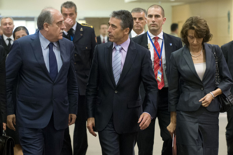 Left to right: Milan Rocen (Minister of Foreign Affairs of the Republic of Montenegro) with NATO Secretary General Anders Fogh Rasmussen and Milica  Pejanovic-Durisic ( Minister of Defence of the Republic of Montenegro) on their way to the North Atlantic Council Meeting Room