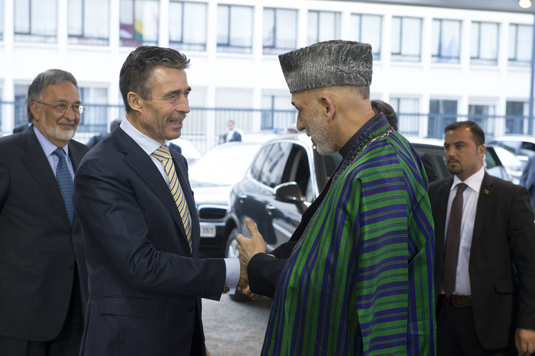 Left to right: NATO Secretary General Anders Fogh Rasmussen greeting President Hamid Karzai (Islamic Republic of Afghanistan) as he arrives at NATO Headquarters