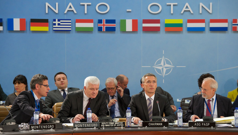 NATO Secretary General Jens Stoltenberg and the Deputy Prime Minister and Minister of Justice of Montenegro, Dusko Markovic in the North Atlantic Council meeting room