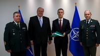 ISAF flag returns to NATO Headquarters from Kabul