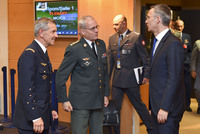 Military Committee in Chiefs of Defence Session - NATO Secretary General shakes hands with the outgoing Chairman of the NATO Military Committee and outgoing Allied Commander Transformation