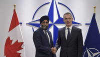 Meetings of the NATO Defence Ministers at NATO Headquarters in Brussels - Bilateral meeting between NATO Secretary General and the Minister of Defence of Canada