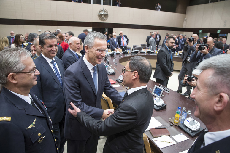 Centre: NATO Secretary General Jens Stoltenberg greeting Tariq Shah Bahrami (Acting Minister of Defence, Afghanistan)
