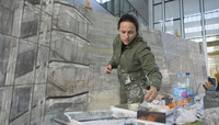 Spanish artist begins large-scale painting project at NATO Headquarters