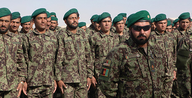 Afghan National Army training instructor, Hakeen Uallah, waits with his recruits prior to their graduation ceremony at the Joint Security Academy Shorabak at Camp Leatherneck, June 16. The Afghan National Army's 215th Maiwand Corps recieved 100 newly trained soldiers after they graduated from the eight-week basic warrior course.