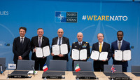 Meetings of the NATO Defence Ministers at NATO Headquarters in Brussels - Signature Ceremony for Memorandum of Understanding for Critical Satellite Communications Services