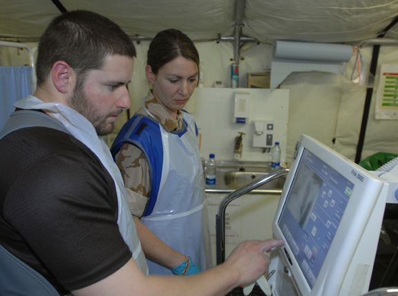 Lieutenant Jo Horn TA and Chief Petty Officer Ian Lindsey Radiographers from 306 field hosptal use their x-ray machine in a real time incident at the new field hospital at Camp Bastion.