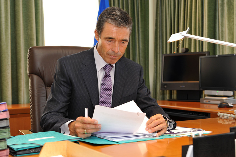 New Secretary General, Anders Fogh Rasmussen sits at his desk for the first time