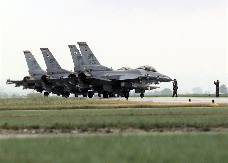 990521-F-4836T-001  Four U.S. Air Force F-16 Fighting Falcons line up at the end of the runway at Aviano Air Base, Italy, for final checks before taking off on NATO Operation Allied Force missions on May 21, 1999.  Operation Allied Force is the air operation against targets in the Federal Republic of Yugoslavia.  The aircraft are deployed to the 31st Air Expeditionary Wing at Aviano from the 20th Fighter Wing, Shaw Air Force Base, S.C.  DoD photo by Tech. Sgt. Steven A. Taylor, U.S. Air Force.  (Released)